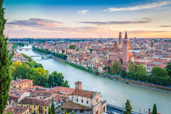 Sunset in Verona, italy. A beautiful sunset in Verona, Italy, in front of a river and the cityscape Royalty Free Stock Photo