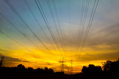 Sunset via pylon tower Stock Photo