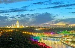 Sunset vibrant view of illuminated Moscow river with bridges, bo. Sunset vibrant panoramic view of illuminated Moscow river with bridges, boats, nice reflections royalty free stock photos