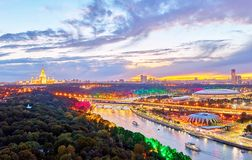 Sunset vibrant view of illuminated Moscow river with bridges, bo. Sunset vibrant panoramic view of illuminated Moscow river with bridges, boats, nice reflections stock photography