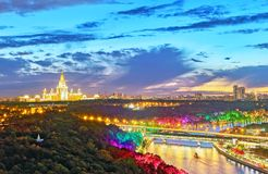 Sunset vibrant view of illuminated Moscow river with bridges, bo. Sunset vibrant panoramic view of illuminated Moscow river with bridges, boats, nice reflections stock images