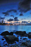 Sunset Victoria. Sunset at Victoria Harbour, Hong Kong, With rock in front royalty free stock images
