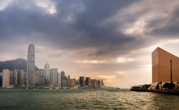 Sunset of Victoria harbor in Hong Kong Stock Images