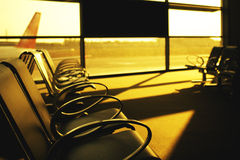 Sunset view from airport lobby with a benches Royalty Free Stock Images