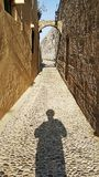 A Sunset View of Rhodes Streets. A Sunset View of Ancient Rhodes Streets with a human shadow stock image