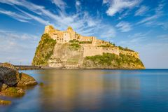 Sunset view of Aragonese Castle near Ischia island, Italy Stock Images