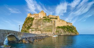 Sunset view of Aragonese Castle near Ischia island, Italy royalty free stock photography