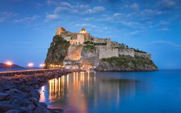 Sunset view of Aragonese Castle near Ischia island, Italy stock photo