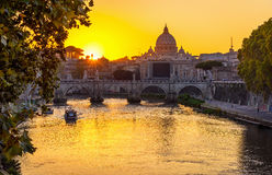 Sunset view of Basilica St Peter, bridge Sant Angelo and river Tiber in Rome Stock Images