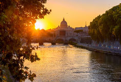 Sunset view of Basilica St Peter, bridge Sant Angelo and river Tiber in Rome Royalty Free Stock Photos