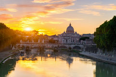 Sunset view of Basilica St Peter and river Tiber in Rome Stock Images