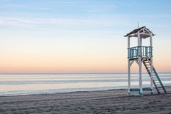 Sunset view of the beach with lifeguard tower stock image