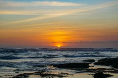 Sunset view from beach near Tanah Lot Temple in Bali Indonesia royalty free stock photo