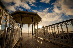Sunset view on beautiful Brighton bandstand Stock Photos