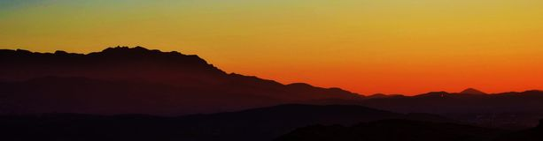 Sunset view. Beautiful sunset sky over a mountain stock photos