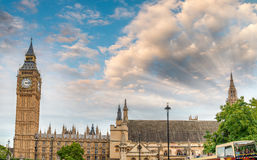 Sunset view of Big Ben and Westminster Palace with city traffic, Stock Photos