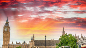 Sunset view of Big Ben and Westminster Palace with city traffic, Stock Image