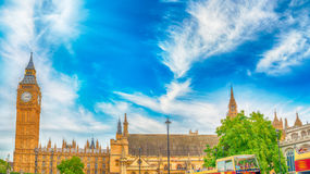 Sunset view of Big Ben and Westminster Palace with city traffic, Royalty Free Stock Photo