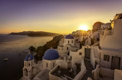 Sunset view of the blue dome churches of Santorini Stock Photos