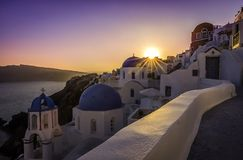 Sunset view of the blue dome churches of Santorini Royalty Free Stock Image