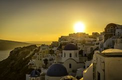 Sunset view of the blue dome churches of Santorini Royalty Free Stock Photos