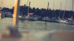 Sunset view from blurred nose of yacht and sun stock footage