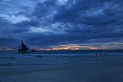 Sunset view in Boracay, Philippines with sailing boat and the ocean Stock Photos