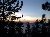 Sunset view from car of Lake Tahoe Royalty Free Stock Image