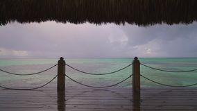 Sunset view of Caribbean sea and tropical beach from wooden pier, Punta Cana resort.  stock footage