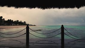 Sunset view of Caribbean sea and tropical beach from wooden pier, Punta Cana resort.  stock video