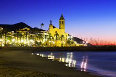 Sunset view of  church at beach. Sitges Stock Photography