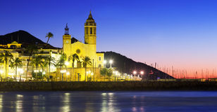 Sunset view of  church at sea beach. Sitges Royalty Free Stock Photo