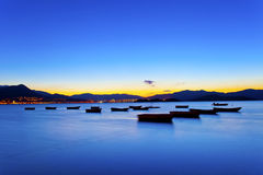 Sunset view by the coast with boats Stock Photography