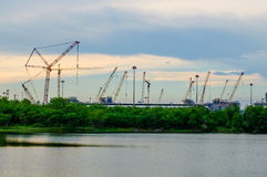 Sunset view with construction cranes at Laemchabang Port. Royalty Free Stock Photography