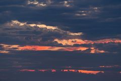 Sunset View Covered by Cloudy Sky Royalty Free Stock Photography