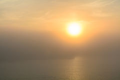 Sunset view from the deck of a boat. Horizontal view of a foggy Royalty Free Stock Images