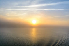 Sunset view from the deck of a boat. Horizontal view of a foggy Stock Images