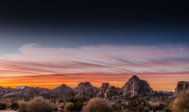 Sunset View of Desert with Wispy Clouds Royalty Free Stock Photography