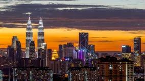 Sunset view in downtown Kuala Lumpur. KUALA LUMPUR, MALAYSIA - 7TH APRIL 2015 : View of The Petronas Twin Towers during sunset on April 7, 2015 in Kuala Lumpur Stock Image
