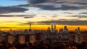Sunset view in downtown Kuala Lumpur. KUALA LUMPUR, MALAYSIA - 16TH JUNE 2015 : View of The Petronas Twin Towers during sunset in Kuala Lumpur, Malaysia Stock Image