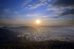 Sunset, view from Drabske Svetnicky, Bohemian paradise on Dneboh village.  royalty free stock photos