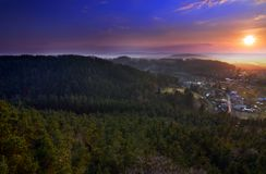 Sunset, view from Drabske Svetnicky, Bohemian paradise on Dneboh village.  royalty free stock photography