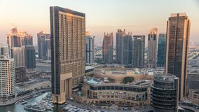 Sunset view of Dubai Marina evening aerial timelapse, UAE. Modern skyscrapers and residential buildings with orange light. Yachts and boats near shoping mall stock video footage