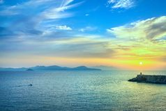 Sunset view of Elba Island and Piombino piazza bovio lighthouse. royalty free stock images