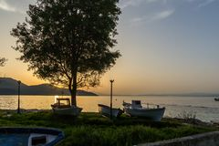 Sunset view on embankment of Thassos town, East Macedonia and Thrace, Greece Royalty Free Stock Images