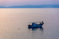 Sunset view on embankment of Thassos town, East Macedonia and Thrace, Greece Royalty Free Stock Photo