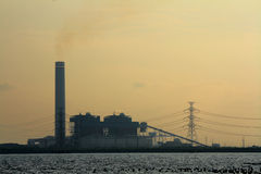 Sunset view of factory. Near the sea Stock Image