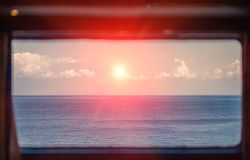 A sunset view from a ferryboat cabin. A beautiful skyline, that is seen in the ferry cabin window. Breathtaking sunset Royalty Free Stock Photos