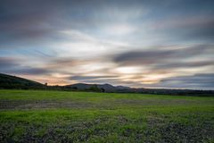 Sunset view from field over to castle ruin Royalty Free Stock Photos