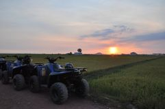 Sunset View with Four Wheels MotorBike royalty free stock images